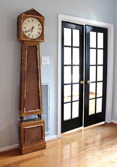 Dark (black) french doors, white trim, gray wall