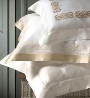 Gianna Embroidery Bedding by Dea Linens. Just the right amount of color on duvets, sheets, shams. Lightweight embroidered detail on cotton. Made in Italy.