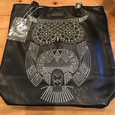 Large black bag with an Owl on it This is a large black bag to wear on your shoulder. The front of the bag has an Owl on it. This bag is plenty big to store all of your belongings. This bag is a MUST!!! Loungefly Bags Shoulder Bags