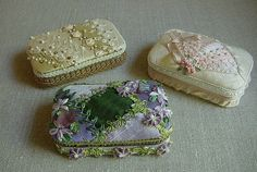 Altered Altoid tins by erika