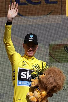 #TDF2016 Chris Froome of Great Britain riding for Team Sky in the yellow leader's jersey poses for a photo on the podium following stage twelve a 178km...