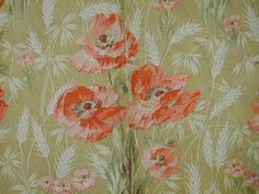 French Art Nouveau wallpaper with reddish-orange poppies and white wheat stalks on a light leaf-green background. Manufacturer and source not named.