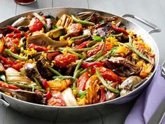 Paella doesn't need fish or meat in order to be delicious. This vegetable paella includes eggplant, mushrooms, artichokes and peppers and has bold flavor and a variety of textures that'll leave you wanting seconds.