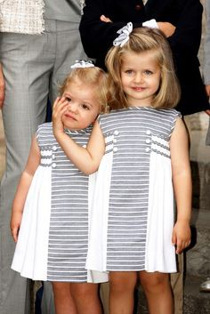 Infanta Leonor and Infanta Sofia, May 24, 2009 Mother would tan my hide if I slapped your check now like I would like to Leonor you spoiled brat, so I will try to poke your eye out without anyone noticing