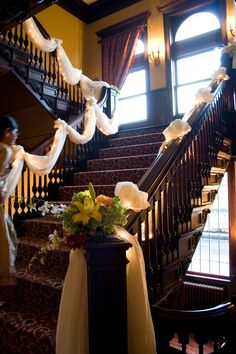 drape on the stairs is beautiful-- could swag it, or wrap around the top of the banister--with tulle you can buy on a bolt