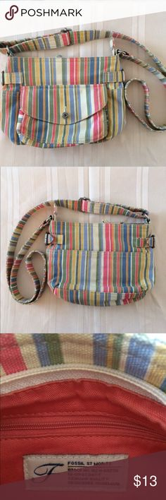 Fossil Mini Stripped shoulder bag Really cute Genuine Fossil mini shoulder bag striped green blue orange yellow white salmon Colors snap pouch on the front interior has two pouches and an extra zippered pouch main purse has a zipper pouch silver detailing on the buckles the size is 9 inches wide by 7 inches length by 2 1/2 inches deep.  There are no visible signs of wear anywhere on the bag   See photos for more details willing to bundle items smoke free and pet free home. Would also be a…