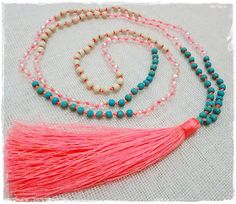 Beaded tassel necklace with coral tassel -  small turquoise and cream stone beads and clear glass crystal beads with a neon coral tassel