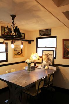 i LOVe the use of small lamps on dining tables, so warm n cozy!!!  (Steve Jones' Very Own Better Shelter)