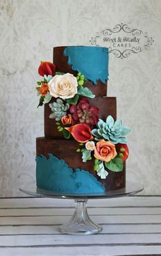 Great colors! Chocolate and Blue Tiered Cake with Flowers