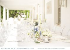 White & silver table decor | Photo: Natural Light Photography, Flowers: BloemenNice