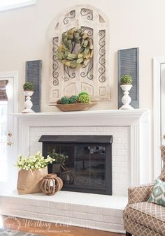 Red brick fireplace painted white with spring decorations #spring #springdecor #springfireplace