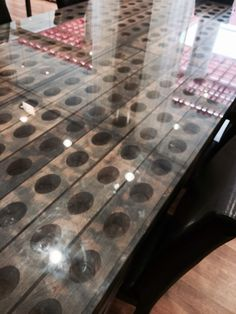 A dining table made out of wine riddling racks in Nappa!