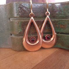 Hey, I found this really awesome Etsy listing at https://www.etsy.com/listing/251489247/lightweight-copper-and-garnet-dangles