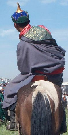 Mongolian rider at the Naadam Festival. The Naadam Festival is the major Mongolian holiday and a wonderful time to experience the culture and people of this amazing land. (V)