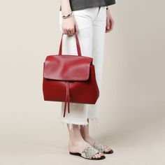 The Mansur Gavriel Lady Bag is an ox blood colored handbag. Made of calf…