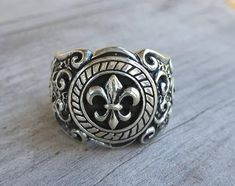 Fleur-de-Lis ring solid sterling silver( 925 ) Flat low set ring It weights 13 to 14 gms depending on the size. Wedding Men, Wedding Rings, Steampunk, Gothic, Celtic Rings, Chunky Rings, Dress Rings, Gold Pendant, Garnet