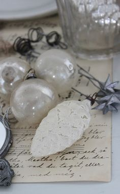 Remove paint from old Christmas bulbs, decoupage with lace and add silver ornament hanger.