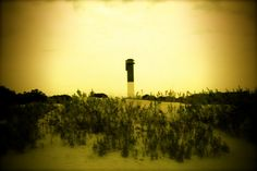 Lighthouse in Sullivans Island, SC, just outside of Charleston. Sullivans Island, Lighthouses, Beautiful Beaches, South Carolina, Charleston, The Outsiders, Public, Spaces, Sunset