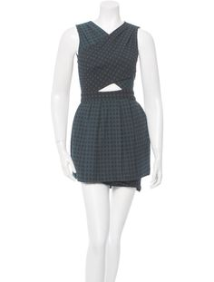 Jade Timo Weiland sleeveless dress with surplice neckline, cutout at waist, pleats at skirt, print throughout and concealed zip closure at center back.