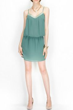 Teal V-neck embellished elastic waist dress. Dress features adjustable straps and is fully lined. This flirty dress can be worn casual with sandals or take it to night with some heels.   Teal Embellished Dress by Naked Zebra. Clothing - Dresses - Casual San Diego California