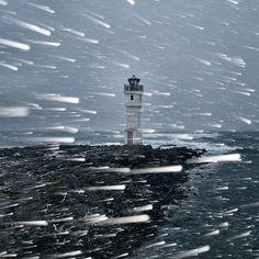 Snowstorm by Atli Harðarson. This is the lighthouse at Skipaskagi, Akranes, Iceland.