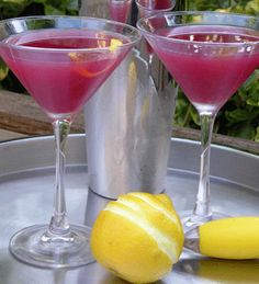 SO GOOD!!!   6 ounces Absolut vodka  4  ounces PAMA pomegranate liquor   2 ounces Limoncello  Add ice and ingredients in a cocktail shaker. Shake well and serve in chilled martini glasses. Garnish with a twist.