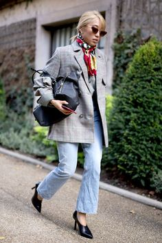 See the street style snaps that are showing us chic ways to style flared jeans right now.