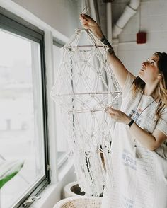 Installing my macrame lantern at @unionpine for a shoot featured on @greenweddingshoes recently. Come learn macrame with me! I'm teaching a bunch of classes in California in June. Sign up at modernmacrame.com