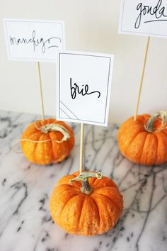 Take advantage of the fact that Thanksgiving falls squarely within pumpkin season. Pick some small, long-stemmed pumpkins from your local grocery store to make these harvest-chic place cards. Find the full instructions at A Fabulous Fete. Table Halloween, Fete Halloween, Fall Wedding, Diy Wedding, Wedding Photos, Wedding Ideas, Sports Wedding, Wedding Songs, Wedding Themes