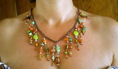 Bib necklace on brown plaited thread.