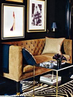 Black Walls, Brown Suede Sofa, and Brass Details Define Rich and Handsome.