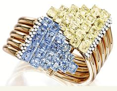 CARTIER 1940's retro bracelet set in rose gold with blue and yellow sapphires