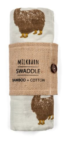 """Incredibly soft! Made with 70% rayon from bamboo and 30% cotton. Packaged in a burlap sleeve with wooden button. Blanket measures47"""" x 47"""". Imported. By MilkBarn Kids (formerly Zebi Baby)."""