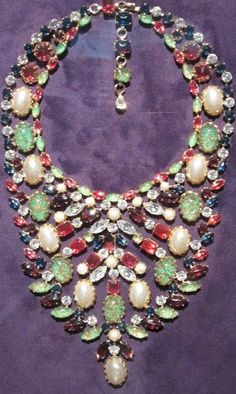 Henry Schreiner got his start designing costume jewelry for Trigère, Norell, and Christian Dior in the late 1940s, but he's best known for the necklaces, pins, and earrings produced by his own firm, founded in 1951.