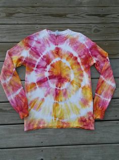 Pink and yellow tie dye shirt!  https://www.etsy.com/listing/216354389/tie-dye-shirt-long-sleeve-tie-dye-shirt