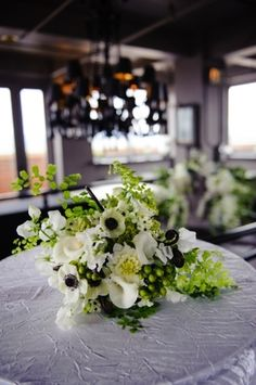 A lovely wedding centerpiece, complete with anemones. Wedding Coordinator, Wedding Planner, Anemones, Arizona Wedding, Wedding Centerpieces, Phoenix, Table Decorations, Weddings, Flowers