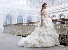 Lazaro Style LZ3213. Ivory organza flounce bridal ball gown, sweetheart neckline, sheer alencon lace bodice, dropped waist, voluminous layered organza skirt, chapel train.