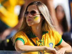 World Cup Brazilian flag green yellow stripes tattoo on face - Brasil world cup Lionel Messi, Stripe Tattoo, Brazil Girls, Hot Fan, Face Tattoos, Thing 1, Fifa World Cup, Yellow Stripes, Sunglasses Women