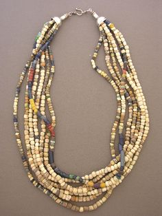 by Anne Holland | A simple seven-strand necklace with an ancient pedigree. Excavated in Mali, West Africa, are a selection of ancient granite, quartz, and glass beads, along with some antique beads from the same region. | Dorje Designs | 625$