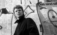 At the Berlin Wall. David Bowie photographed by Denis O'Regan, 1987.