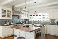 Elegant look: gray subway tile, warm wood island, white cabinetry -- Santa Monica Beach House | Evens Architects