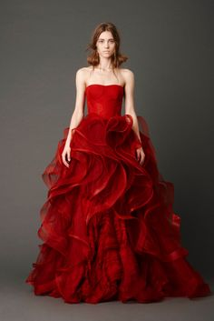 Vera Wang Bridal Spring 2013 Scarlet strapless ballgown with tulle panel skirt and embellished flange appliqué and floating Chantilly lace detail.