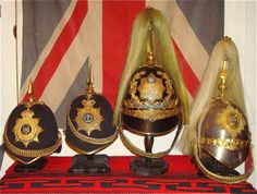 Officersm Headgear:from L to R: Northamptonshire Regt  Middlesex Regt.    Kings VII Own Imperial Yeomanry Victorian Innniskilling Dragoon Guards