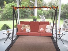 My favorite place to relax is this swing on my porch. Decorated for autumn.