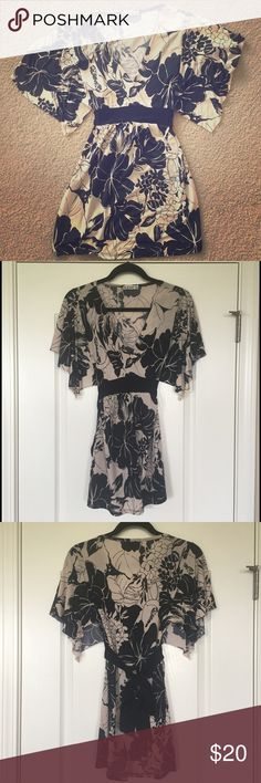 Black & Cream Floral Blouse Beautiful Black & Cream floral blouse. Deep V neckline with tie back. Excellent Condition. Unknown Tops Blouses
