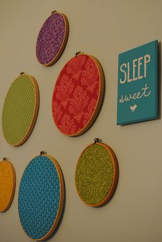 i like the embroidery circles. get the color coordinated fabric swatch packs. cheap wall art