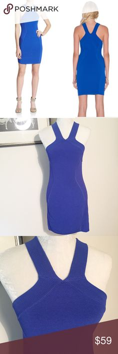 "Parker Powerknit Body con dress cobalt Richly ribbed powerknit rendered in a vibrant hourglass silhouette with V front and back and cutaway arm openings. Pullover style. Size medium. Rayon. Overall length 35"". No flaws. Parker Dresses Mini"