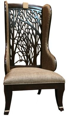 Wings Of Forest  Wings Of Forest. 2012- This chair is a contemporary variation of the Victorian wing chair. An intricate 'Jaali'at the back has been carved out of solid wood in between the wings. The design of the 'jaali' is inspired from the forest. A close look at it and you will see a tree trunk at the base from which branches are emerging. The cushions in the wings and seat ensure that the comfort of the user nor the 'Victorian styling' have been compromised in any way.