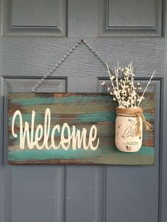 Pin now for later! Rustic Welcome Wood Sign makes the ultimate housewarming gift. The mason jar adds a unique touch! Outdoor Teal & Green Welcome Sign - Size is approximately 12 X 18 inches - Comes ready to hang - Light sealer applied - New Wood -Flo Outdoor Welcome Sign, Welcome Wood Sign, Outdoor Signs, Welcome Signs Front Door, Rustic Wood Walls, Rustic Doors, Rustic Signs, Diy Wood, Wall Wood