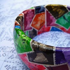 postage stamp bangle - i think my parents have some WWII era stamps down in the basement...
